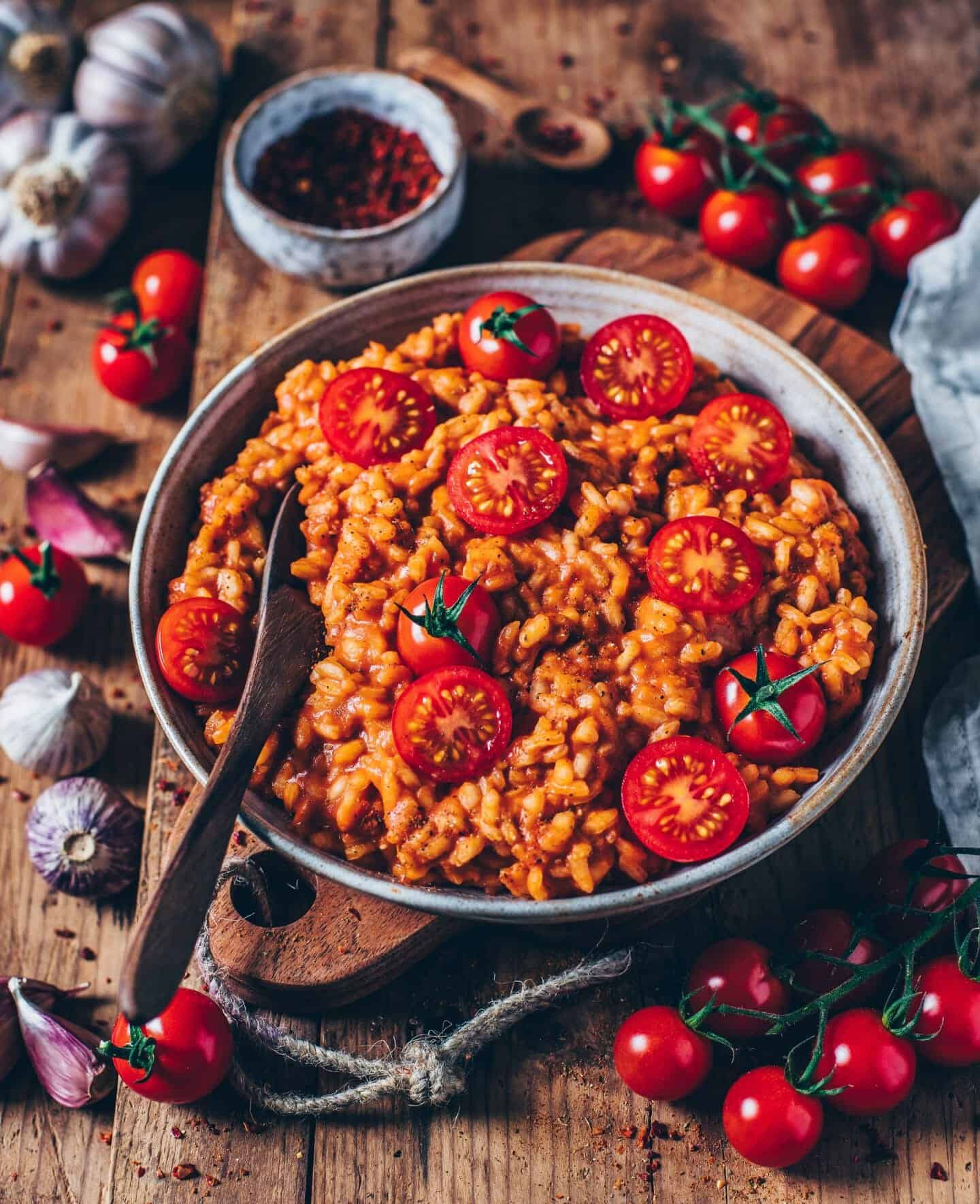 This creamy vegan tomato risotto is easy and quick to make and incredibly delicious! A perfect gluten-free & plant-based lunch or dinner.