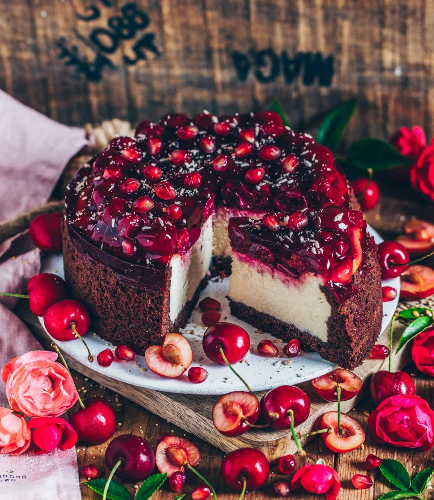 This baked vegan cheesecake with cherries and chocolate crust is a delicious refreshing light cake with a wonderfully creamy filling and juicy topping. Freshly chilled from the fridge, it's a perfect dessert for warm summer days. This cake is easy to make and dairy-free.