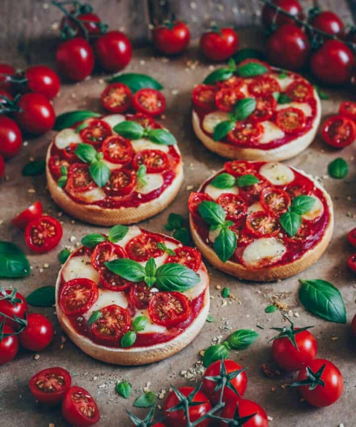 mini pizza toast with tomatoes mozzarella and basil