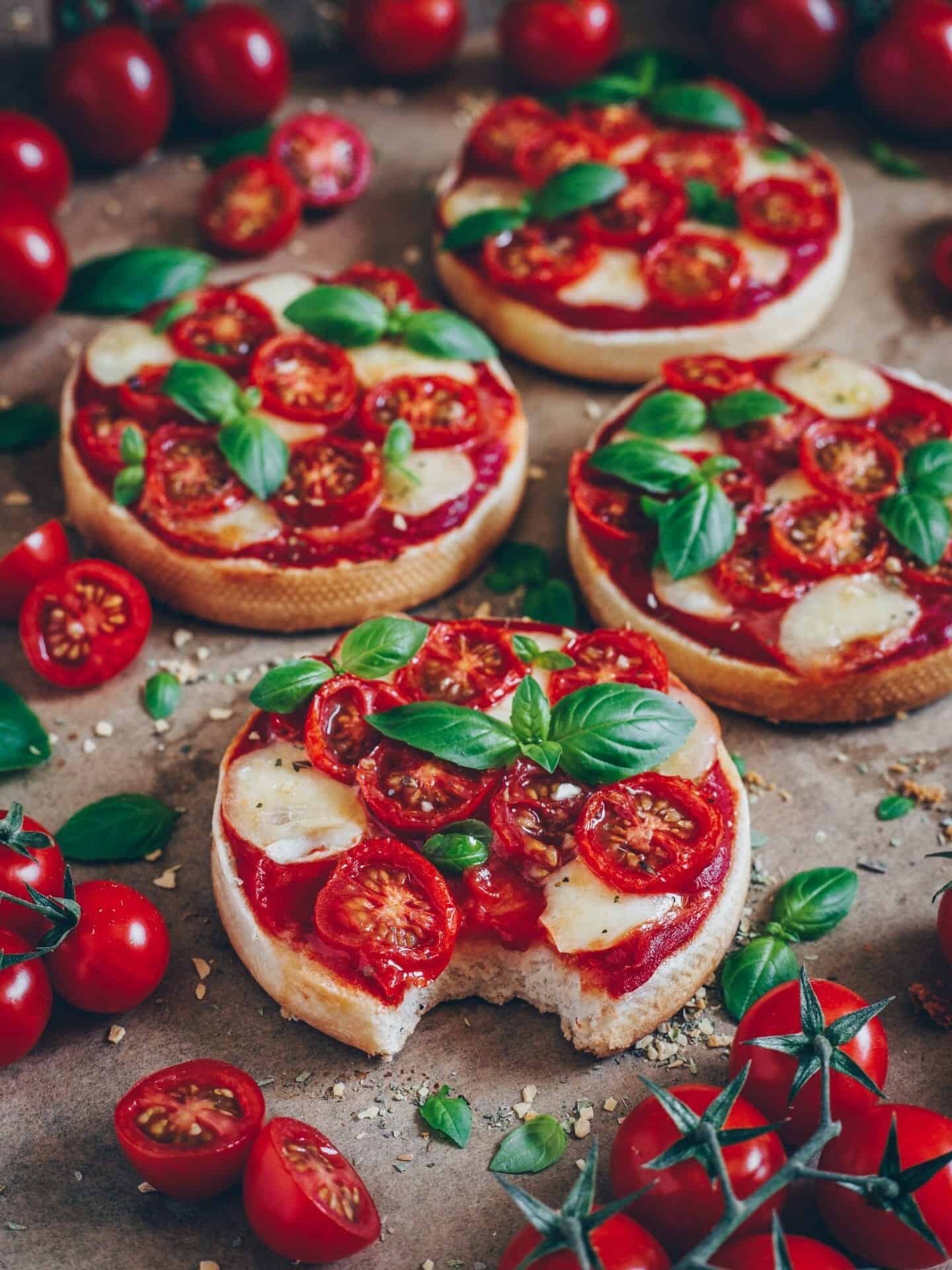 mini pizza toast with tomatoes mozzarella and basil