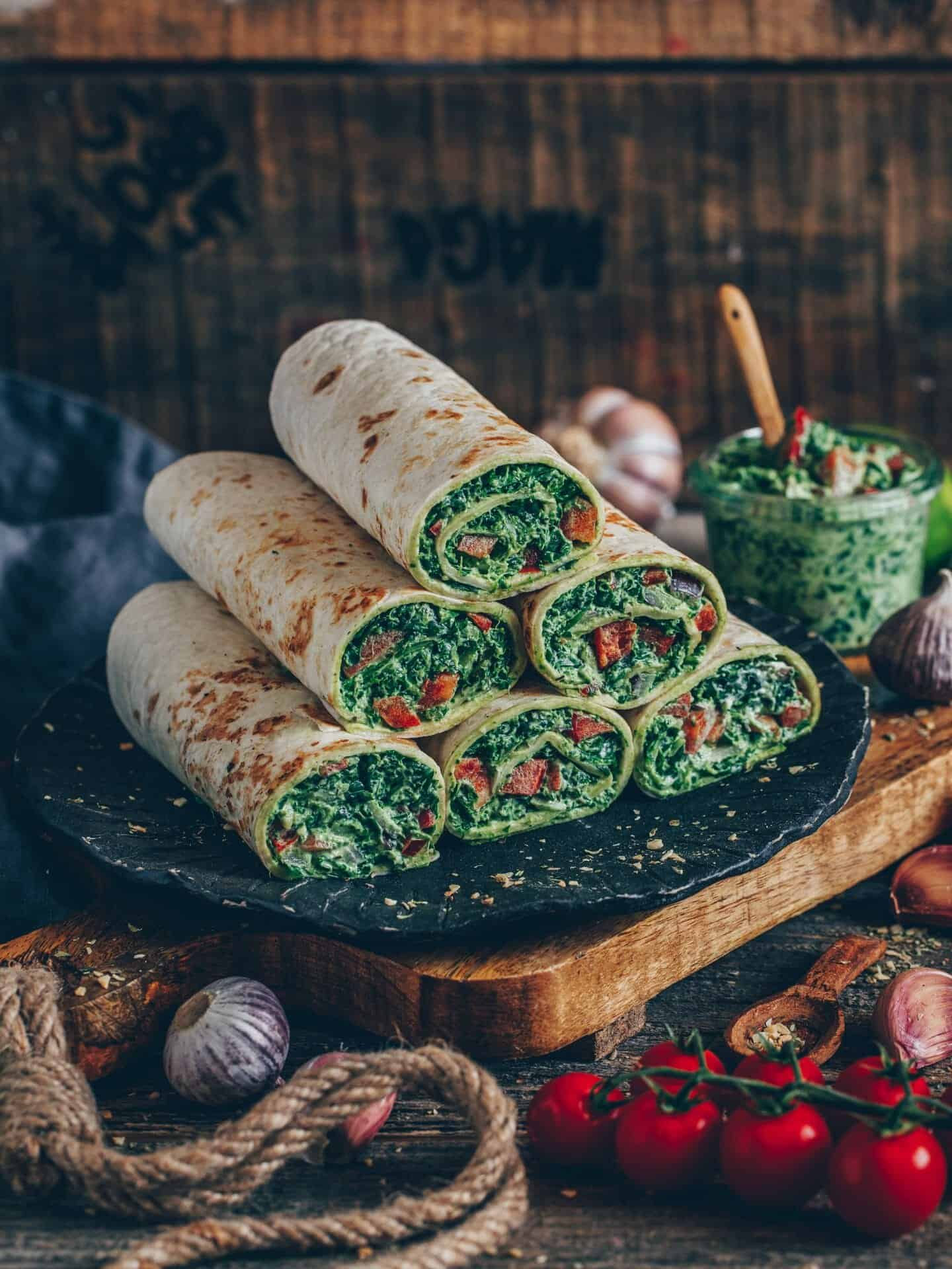 Wraps (tortillas) with spinach and cashew cheese. This easy and quick recipe is vegan, gluten-free, dairy-free, healthy and delicious.