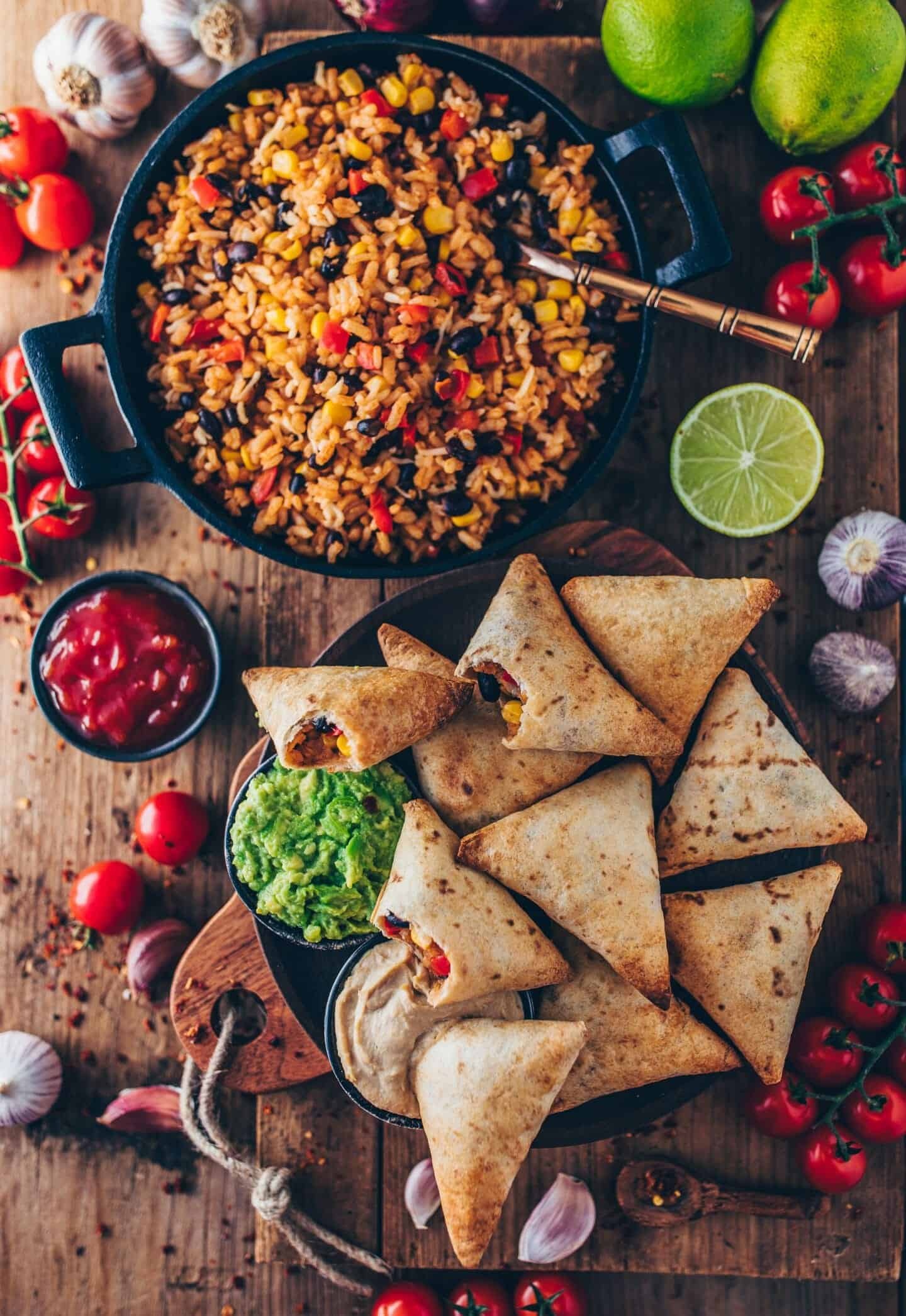 vegan burrito samosas with mexican rice, guacamole, salsa
