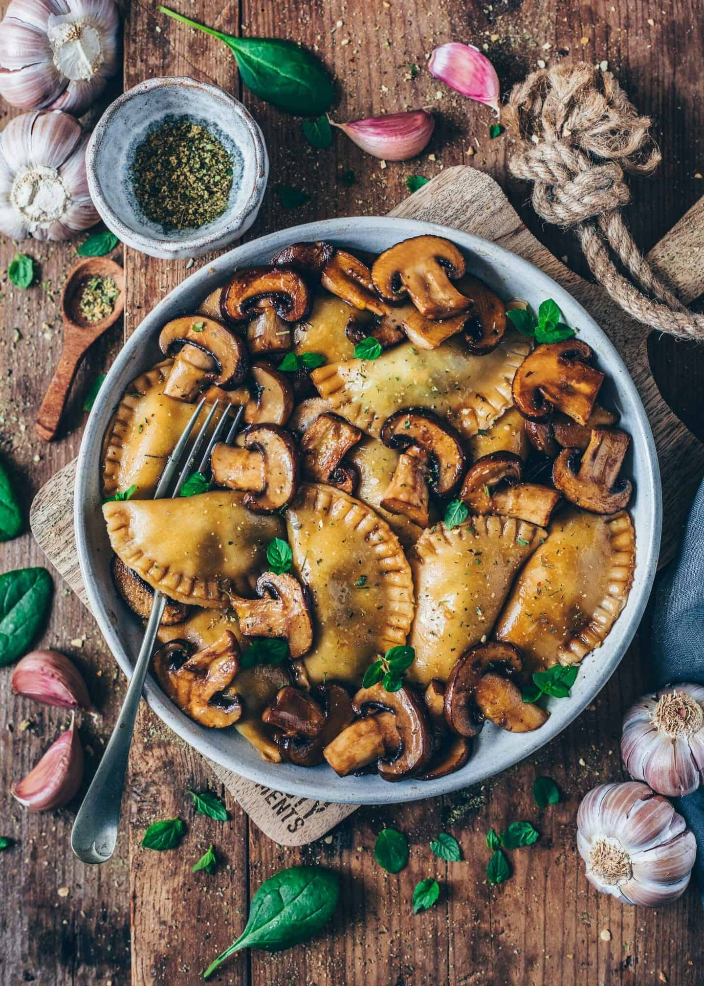 These homemade vegan spinach ravioli with fried mushrooms is the ultimate comfort food. It's a simple recipe that is delicious and healthy.