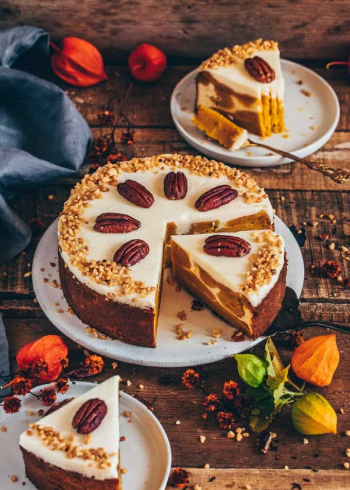 This Vegan Pumpkin Cake swirled with creamy Cheesecake is super moist, fudgy, perfectly spiced and so delicious. The recipe is very easy and can be made sugar-free and gluten-free.