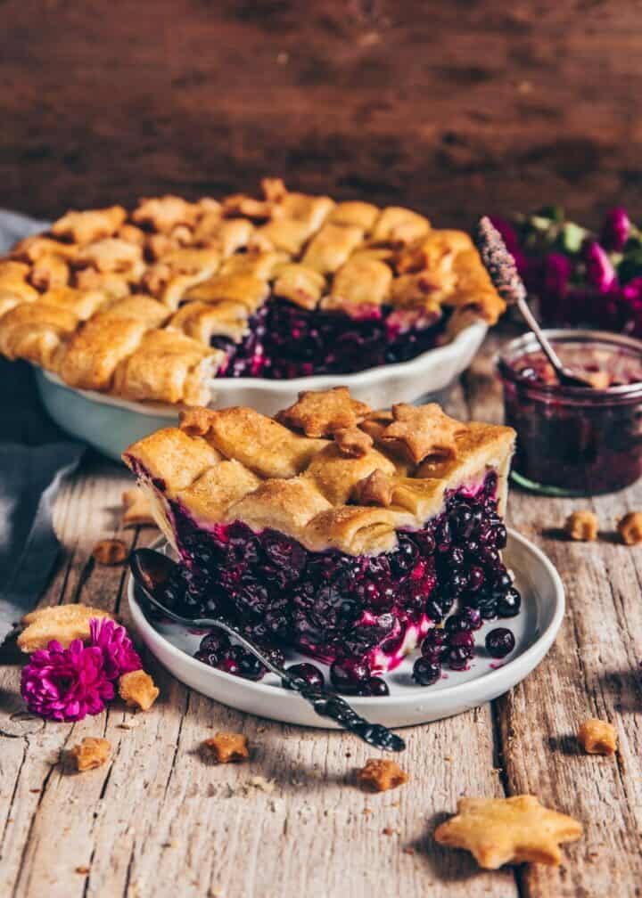 The best Blueberry Pie with a fruity, juicy filling and a flaky, crispy vegan pie crust. This recipe is so easy to make, and it's incredibly delicious! It's the perfect dessert for any occasion.