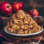 This vegan oven baked Apple Toast Roll-Ups are super easy to make in just 20 minutes. It's a delicious breakfast or dessert with a sweet apple cinnamon filling. Serve them warm and crispy for a perfect snack.