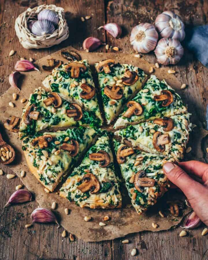 This cheesy vegan garlic mushroom and spinach pizza is perfect when you want a quick dinner that's not only delicious, but also healthy! This recipe is simple and, and it's the best pizza you will ever have.