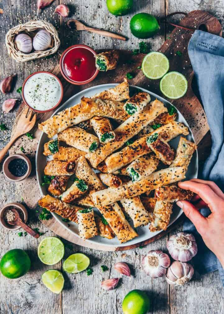 Crispy baked Turkish Borek (Vegan Spinach Rolls) are quick & easy to prepare and make a great finger food! You can fill them with different fillings, such as spinach and feta or cashew and tomato. They're perfect to serve at a party or just as a simple and delicious snack or side dish for dinner or lunch.