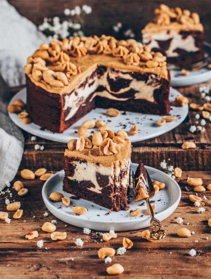 If you love chocolatey brownies and creamy cheesecake, this vegan brownie cheesecake will be your new favorite dessert! It's moist, rich, can be made gluten-free, and it's topped with a delicious peanut butter frosting! The perfect vegan cream cheese swirl brownies as a chocolate cake for any time!