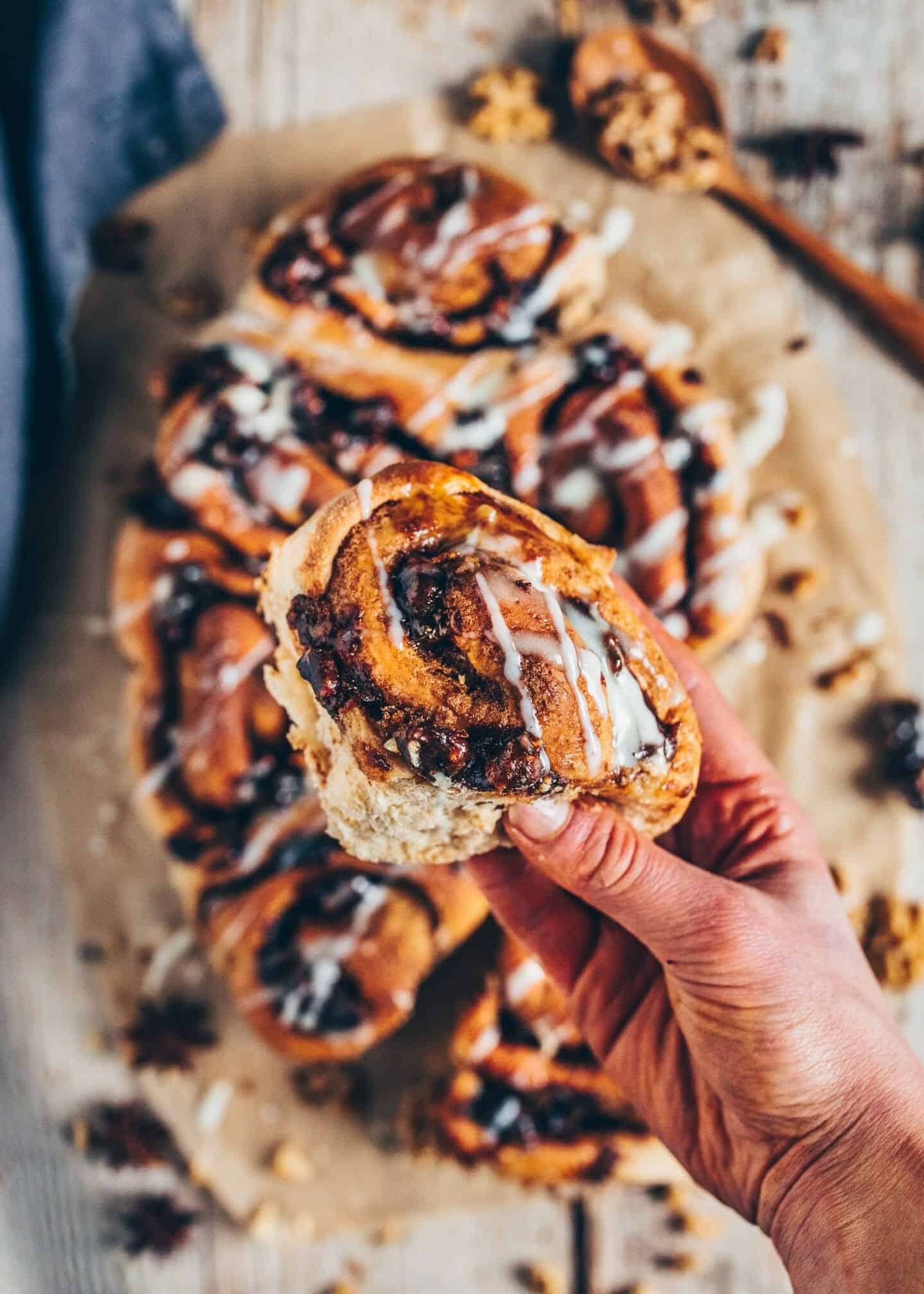 Best easy vegan cinnamon rolls with cashew frosting. They're soft, fluffy, and delicious. Furthermore, they're healthier than the average cinnamon buns are because they contain no white sugar, no eggs and are dairy-free! Ideal for a snack, breakfast or dessert.