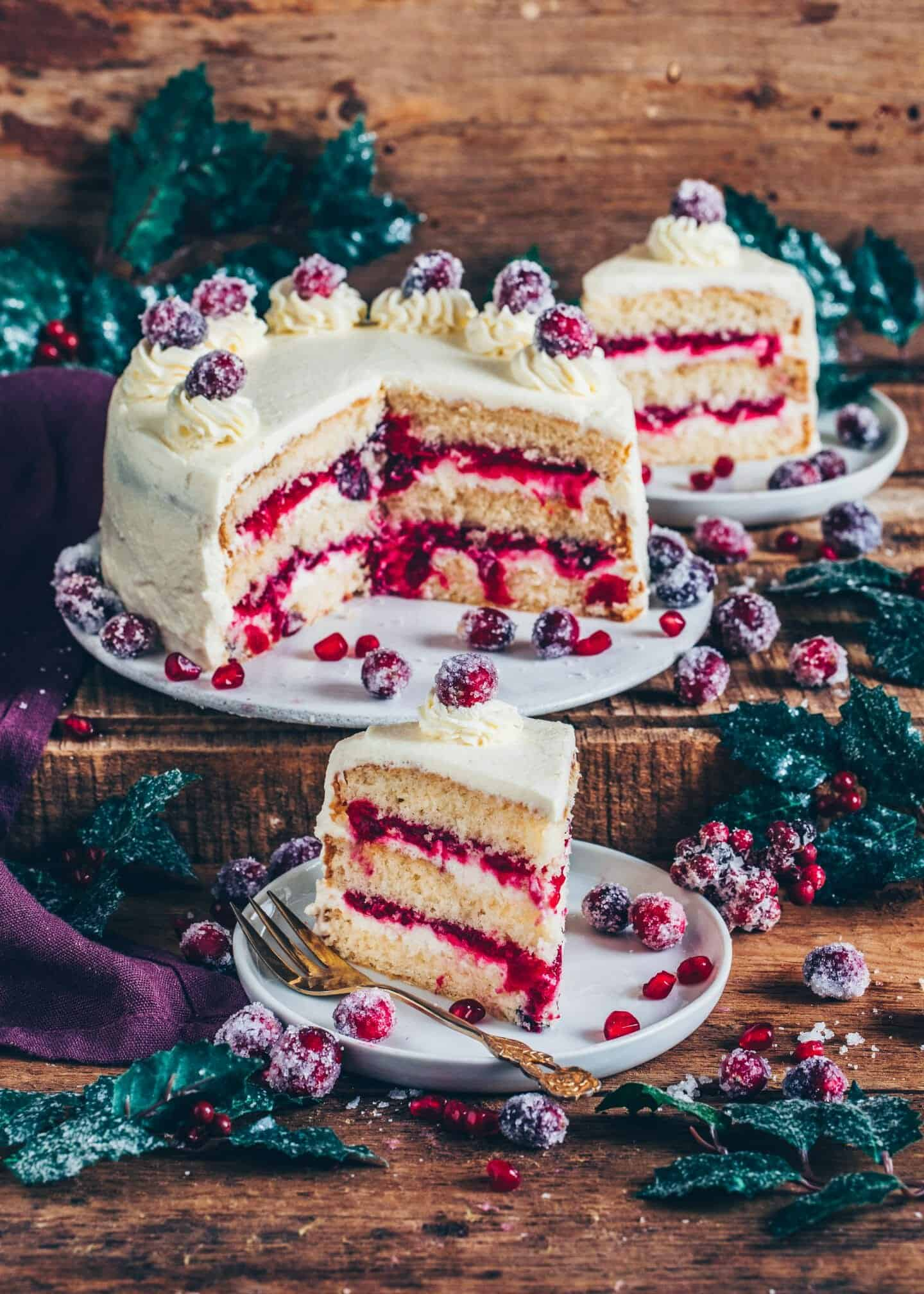 This Cranberry Cake is made of fluffy Vegan Vanilla Cake layers, a homemade Cranberry Compote Filling and a creamy Frosting. It's not only the perfect Christmas Cake but also for any time!