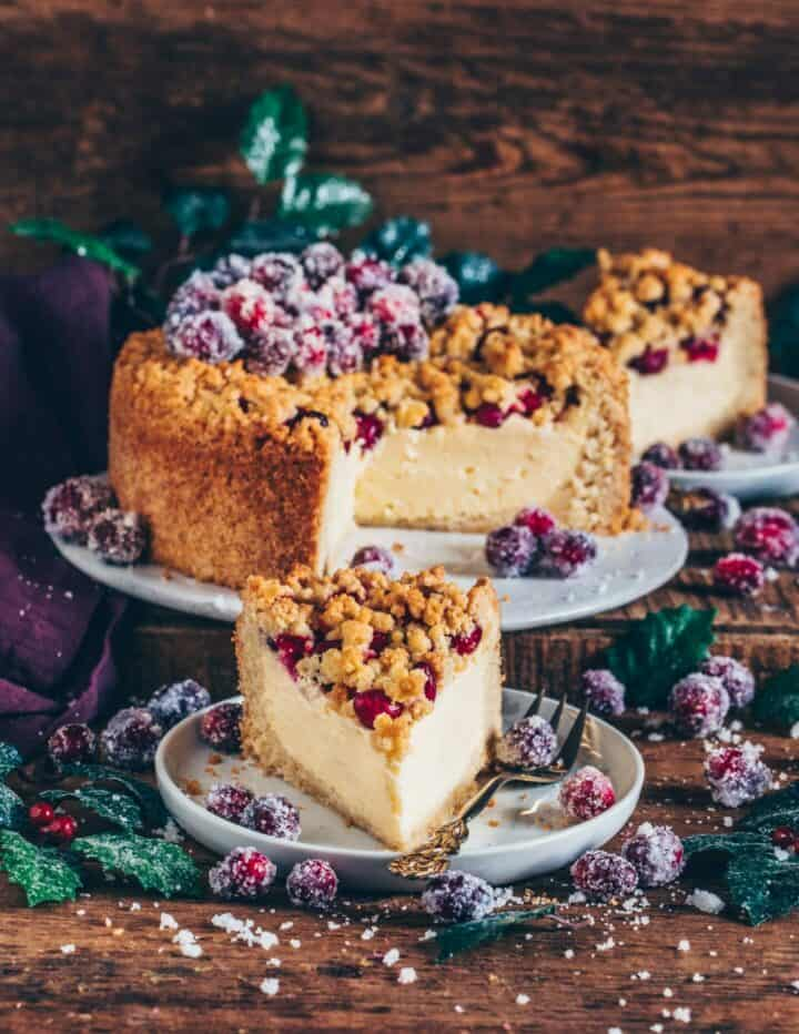This Cranberry Crumb Cake not only looks incredibly festive, but it also tastes super delicious! It's layered with vegan Cheesecake and topped with Sugared Cranberries making it the perfect dessert for Christmas, ok let's be honest, it's actually perfect any time!