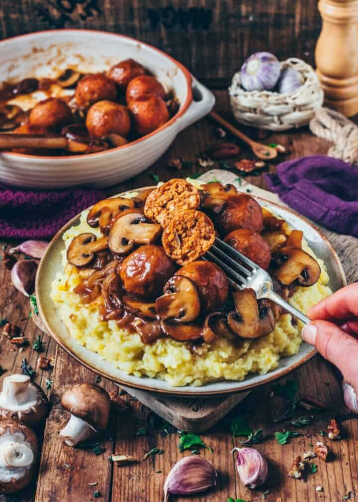 These easy to make No-Meat Balls (Vegan Meatballs) are the ultimate comfort food! Serve them over Mashed Potatoes and drench them in Mushroom Gravy for a perfect Christmas dinner or any time!