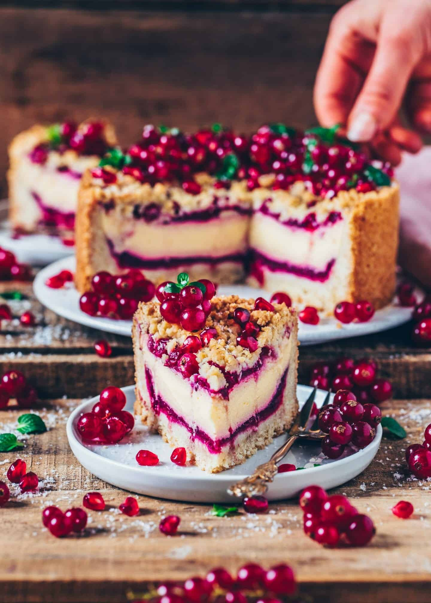 This vegan Currant Cheesecake with Streusel combines a Crumble Cake and a Cheesecake into one delicious dessert. It's the perfect combination, making for an amazing Vegan Cake for any occasion. You'll love how easily it can be made!