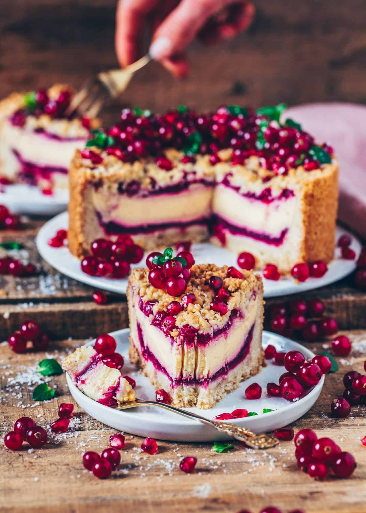 This vegan Red Currant Cheesecake with Streusel combines a Crumble Cake and a Cheesecake into one delicious dessert. It's the perfect combination, making for an amazing Vegan Cake for any occasion. You'll love how easily it can be made!