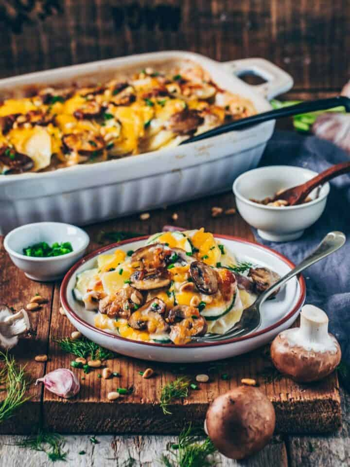 "This Vegan Potato Bake (Potatoes au Gratin) with Mushrooms and Zucchini is comfort food at its best! It's creamy, flavorful, ""cheesy"", healthy, satisfying and very easy to make! Perfect as a main course or side dish for any type of meal."