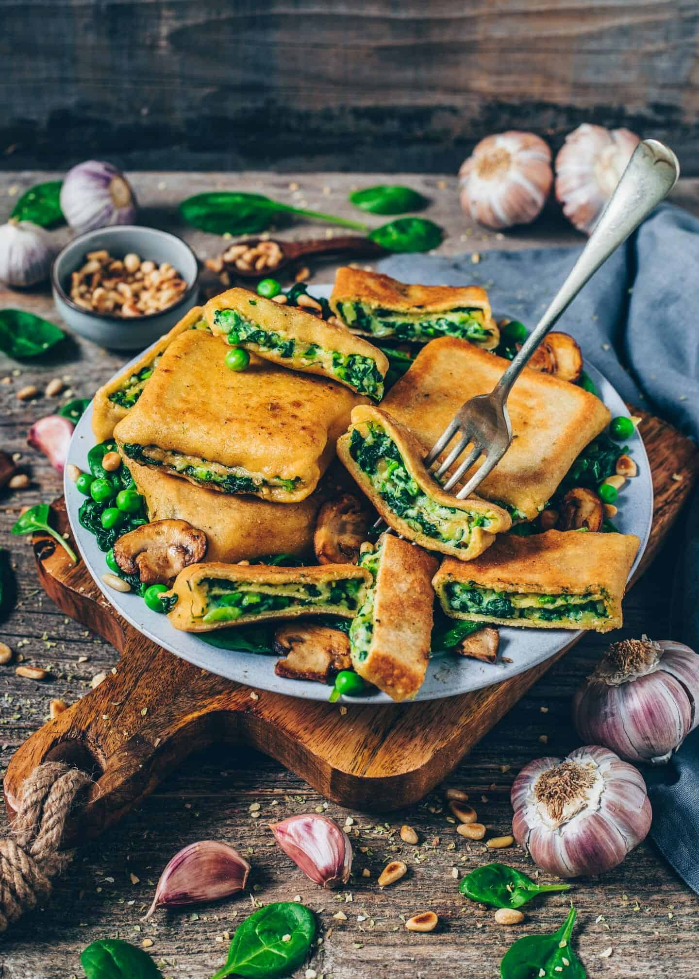 Crispy roasted Vegan Ravioli Pockets (German Maultaschen) are filled with a creamy cheesy potato, spinach & pea filling. These pasta squares are easy to make, very delicious, and perfect for lunch and dinner or to make ahead.