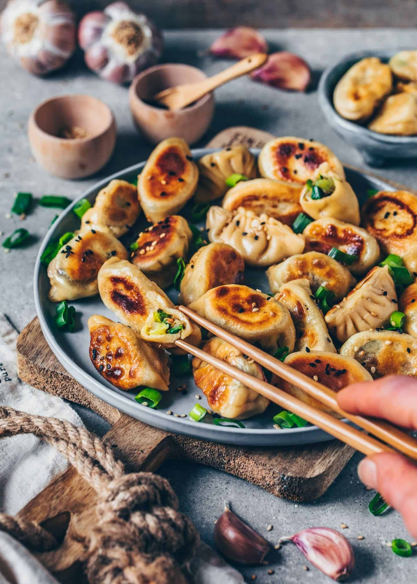 Crispy pan-fried Vegan Gyoza (Jiaozi) are Japanese Vegetable Dumplings, also called Potstickers. They're made of simple Homemade Dumpling Wrappers and filled with healthy veggies. This recipe is fairly easy and includes step-by-step instructions.