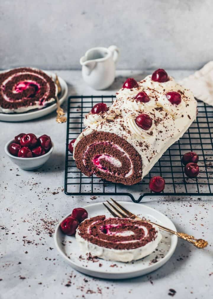 This Black Forest Cake Roll (Vegan Swiss Roll) is a fluffy Vegan Chocolate Sponge Cake with a cherry cream filling rolled into a Yule Log. Quick and easy to make! No eggs required. Egg-less Recipe.