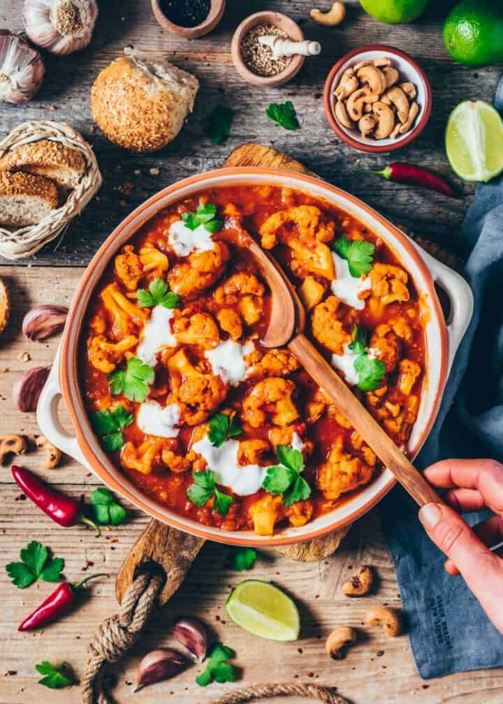 This Vegan Cauliflower Tikka Masala Curry is packed with flavor, protein from red lentils, and best of all, it comes together in less than 20 minutes in one pot! Making this a delicious, healthy and gluten-free lunch or dinner, that's super easy to make.