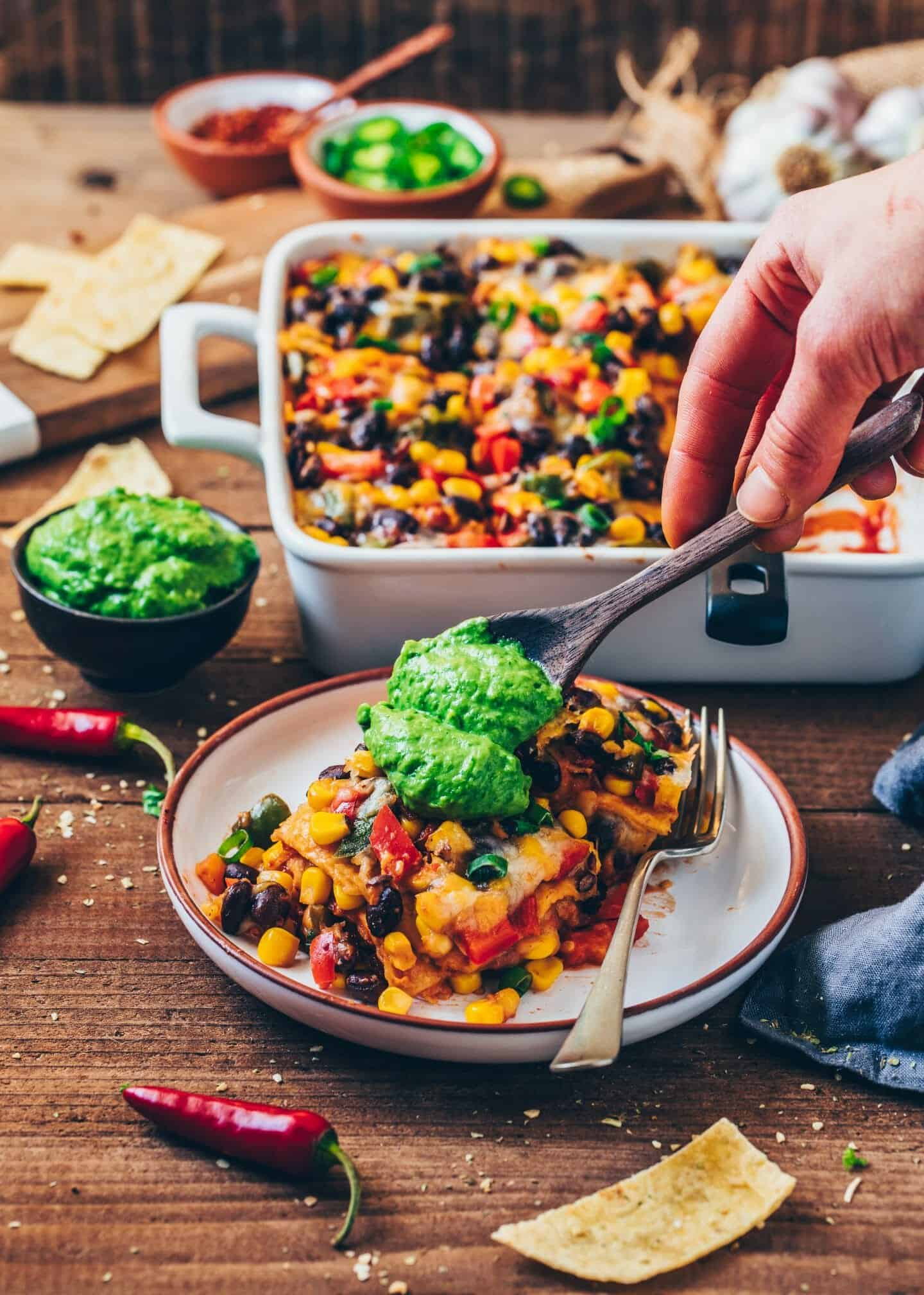 This Mexican Tortilla Casserole is an easy to make, healthy and delicious Vegan Enchilada Lasagna loaded with Vegetables and gluten-free Corn Tortillas.