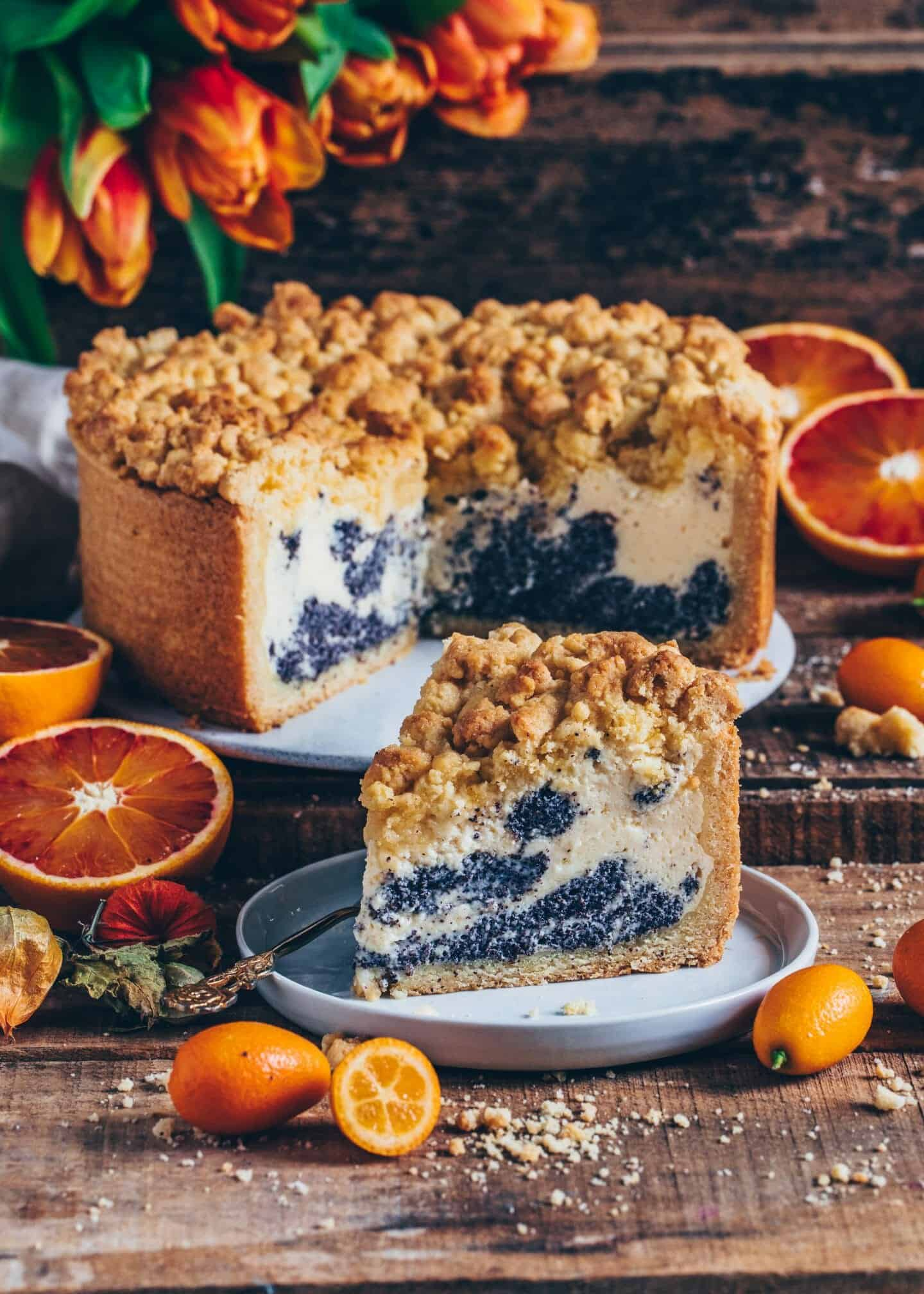 This Poppy Seed Crumble Cake features a delicious Cheesecake layer with dollops of a poppy seed filling, making it to the perfect dessert! Easy Recipe.