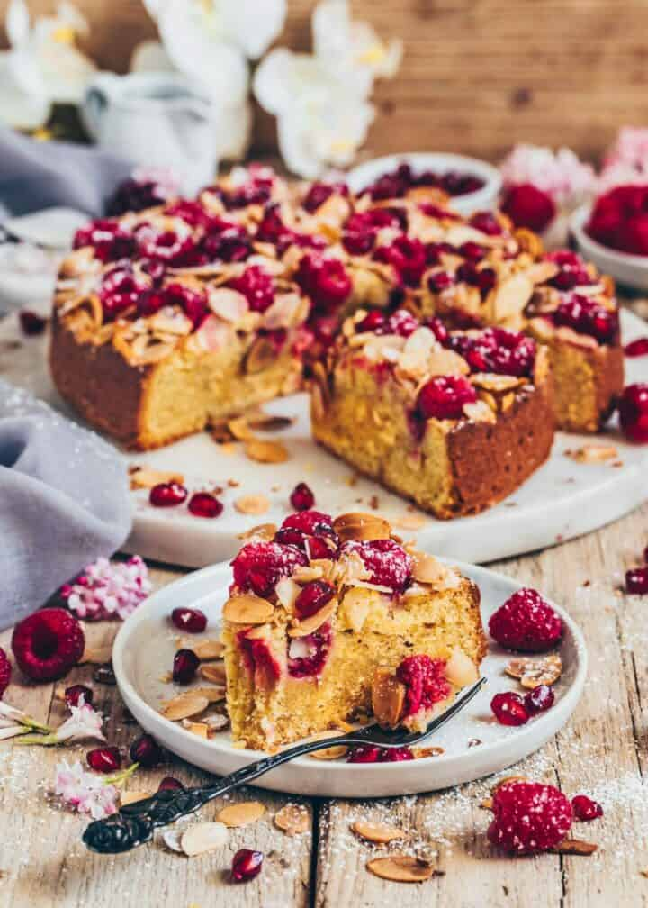 This Raspberry Almond Orange Cake Recipe is quick and easy to make in one-bowl. It's delicious, nutty, moist, juicy, healthy, gluten-free, egg-less, with a crunchy almond topping.