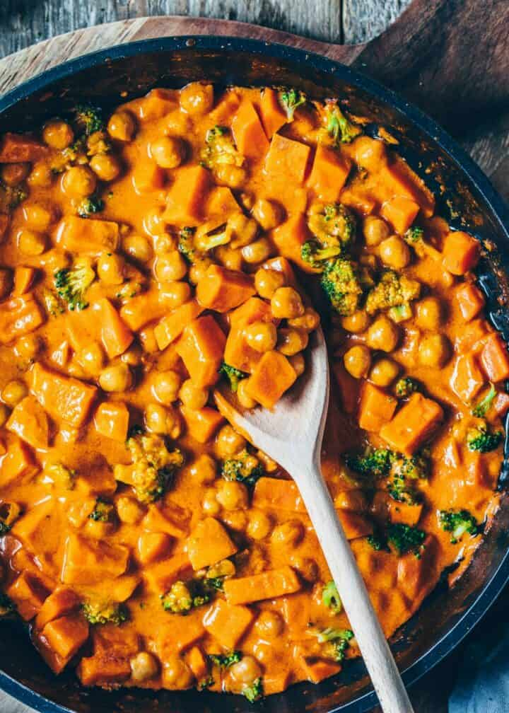 Creamy Sweet Potato, Chickpea and Coconut Curry Recipe with Broccoli. It is quick and easy to make, vegan, healthy, delicious.Perfect comfort food for lunch, dinner, mealprep. Freezer friendly, gluten-free.