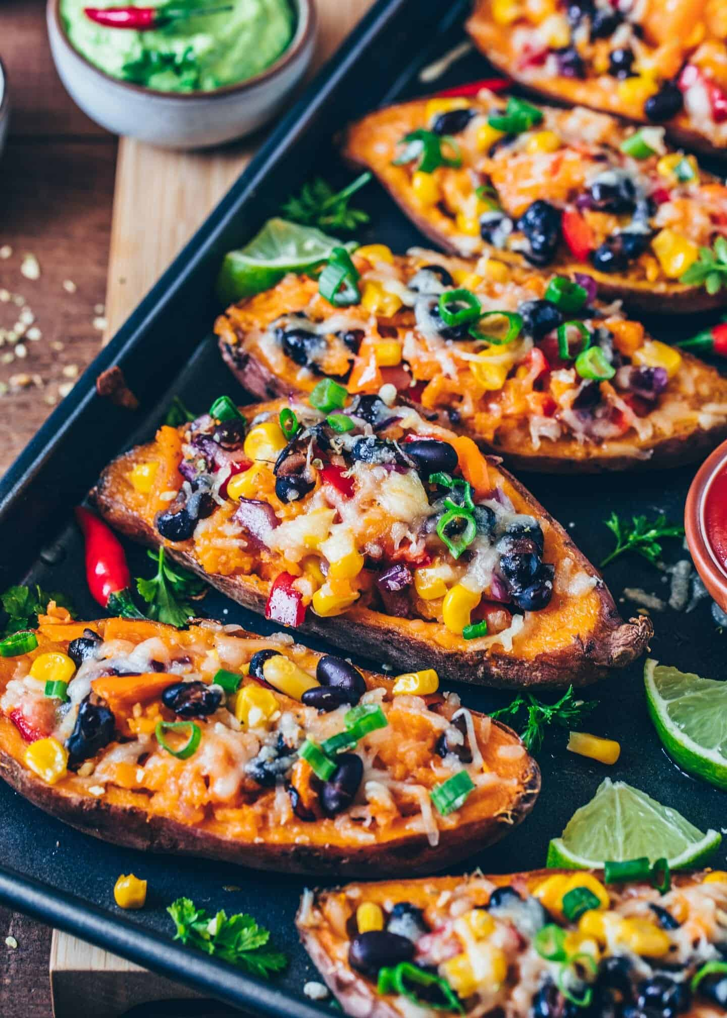 Mexican Sweet Potato Skins stuffed with black beans, corn, pepper, and vegan cheese. Serve with homemade avocado aioli for a tasty, easy and healthy meal. How to make baked potatoes. Step-by-step Recipe. Dairy-free, gluten-free.