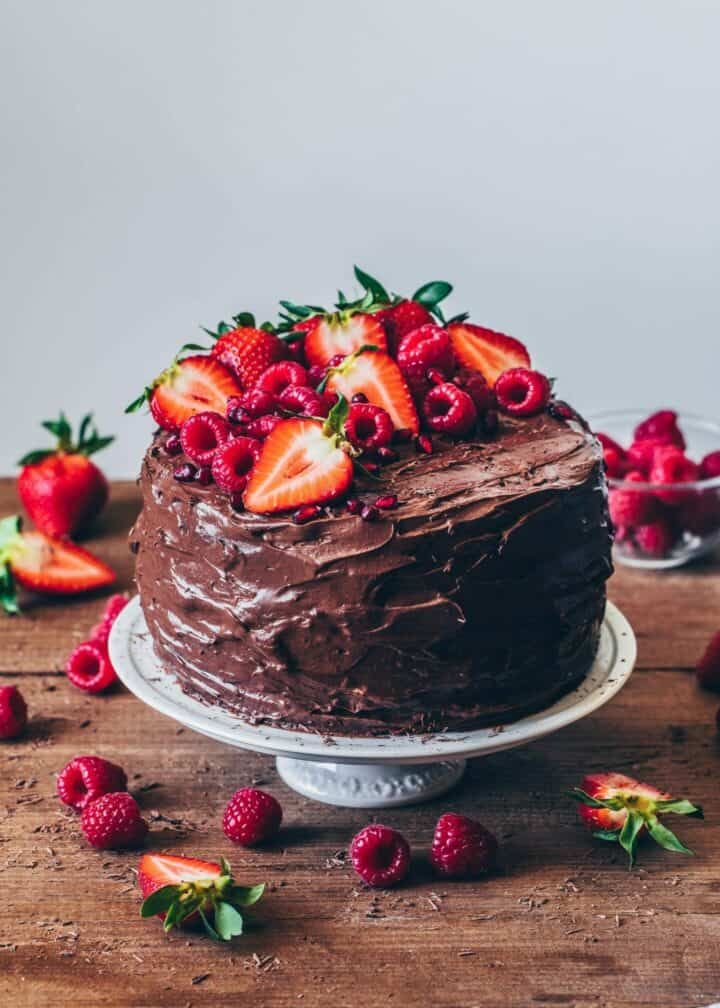 Chocolate Raspberry Cake recipe. How to assemble a layer cake step-by-step. Vegan chocolate cake with chocolate mousse and homemade raspberry jam.