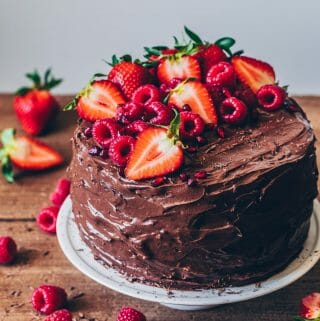Chocolate Raspberry Cake recipe. How to assemble a layer cake step-by-step.bVegan chocolate cake with chocolate mousse and homemade raspberry jam.