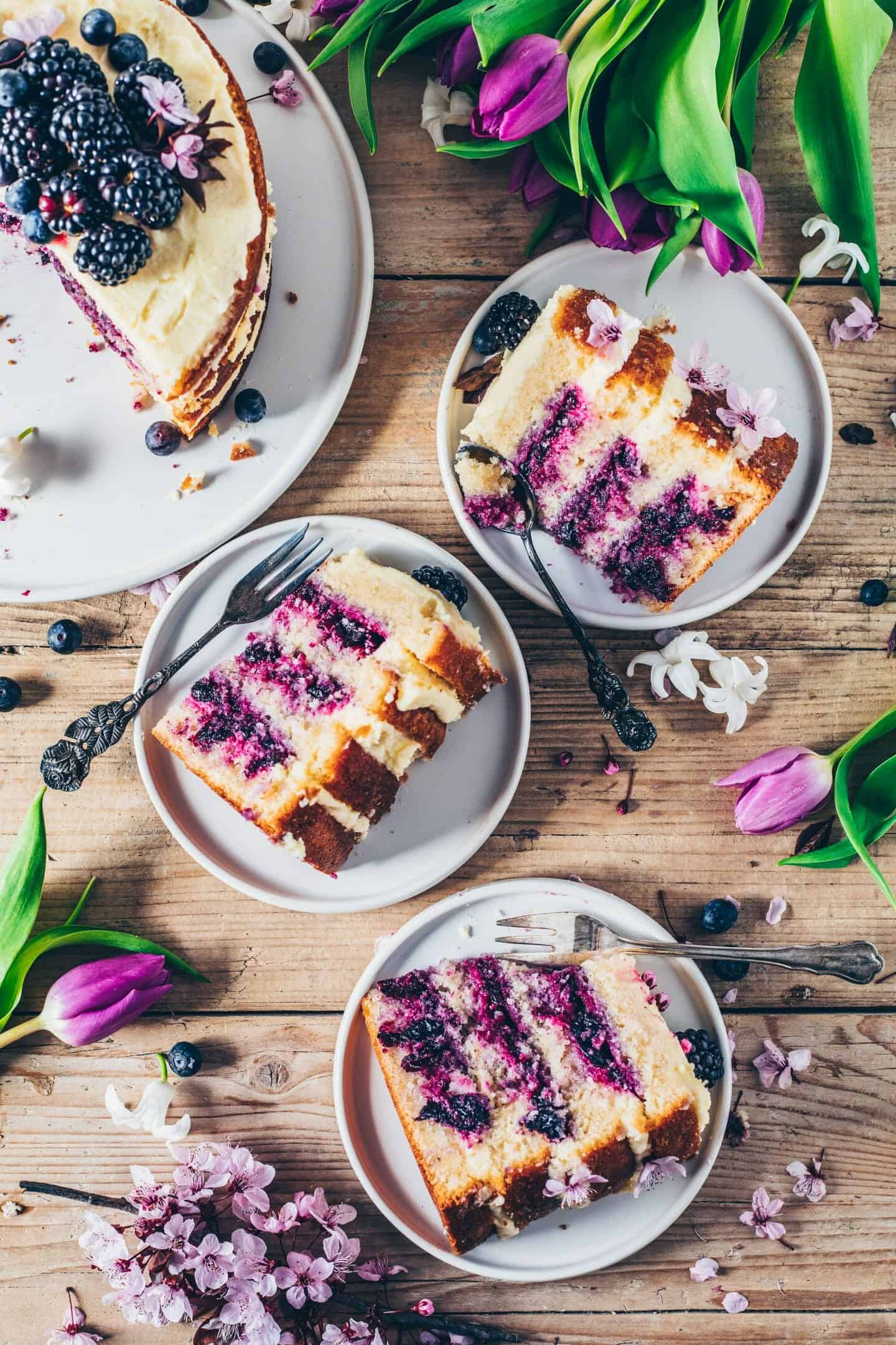 Lemon blueberry cake is a vegan layer cake with creamy lemon frosting and blueberry filling. It is soft, moist, delicious. Perfect dessert for Easter. Gluten-free, egg-less recipe.