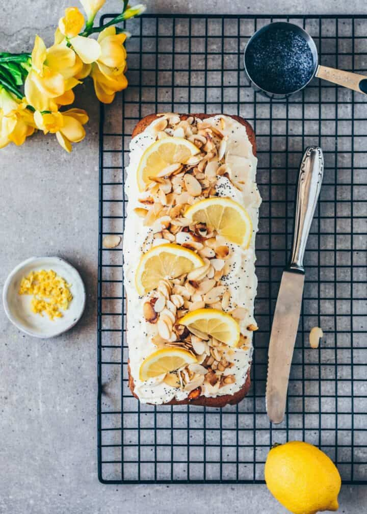 How to make vegan Lemon Poppy Seed Cake with Cream Cheese Frosting and almonds. It is soft, moist and delicious with a fresh lemon flavor. The recipe is quick and easy to make in one-bowl, with a gluten-free option. Step-by-step pictures.