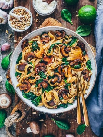 A quick recipe for Vegan Mushroom Pasta with Spinach. This pasta dish is delicious, healthy and easy to make. It's ready in only 15 minutes and makes a perfect simple dinner or lunch.