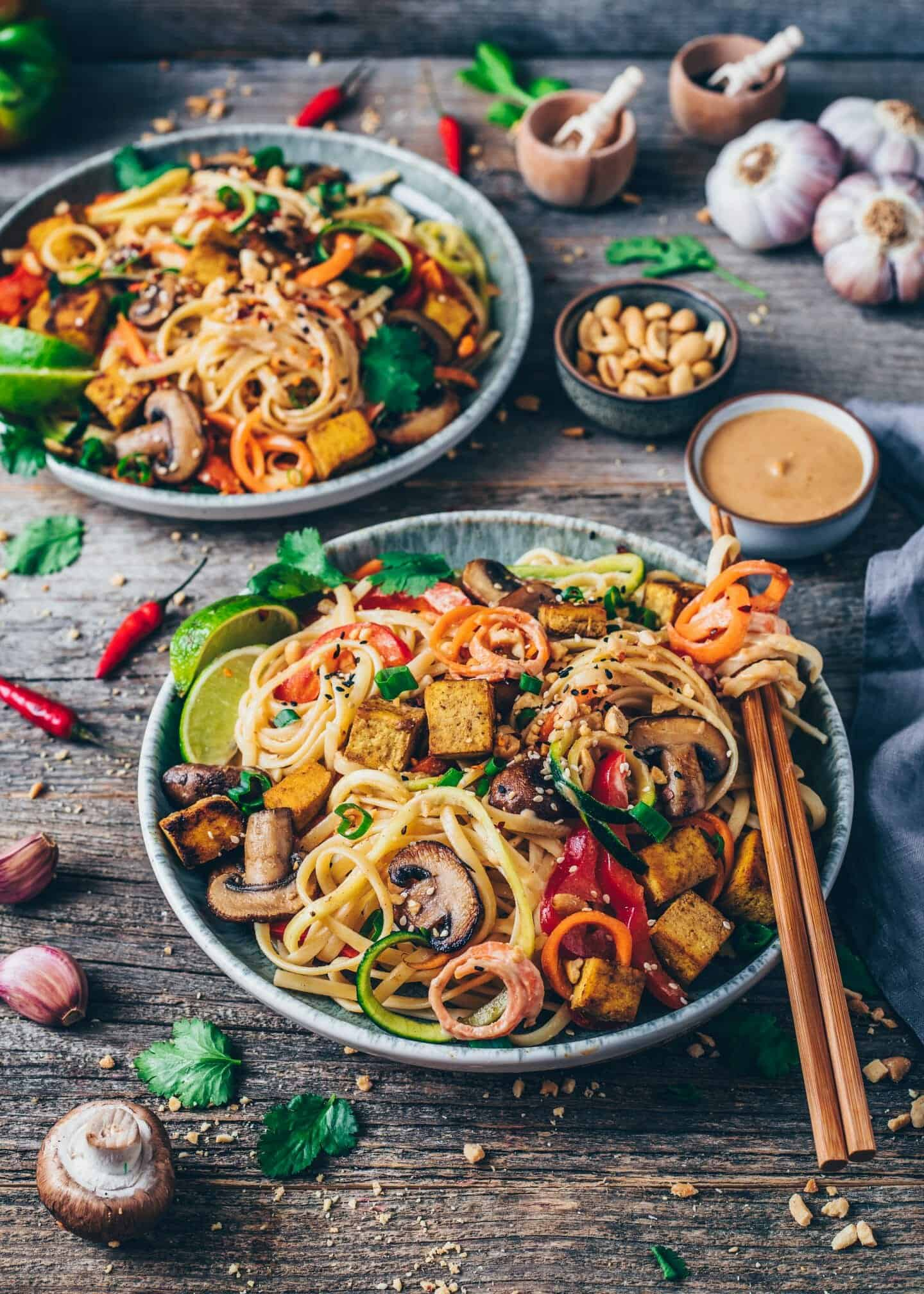 Vegan Pad Thai with crispy tofu, vegetable noodles, creamy peanut sauce. Quick and easy Recipe, healthy, delicious, gluten-free. Carrot noodles, Zucchini Noodles, mushrooms.