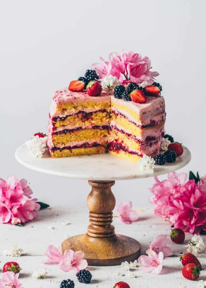 Strawberry Lemon Cake recipe from scratch. Vegan lemon layer cake with homemade blackberry jam and strawberry frosting.