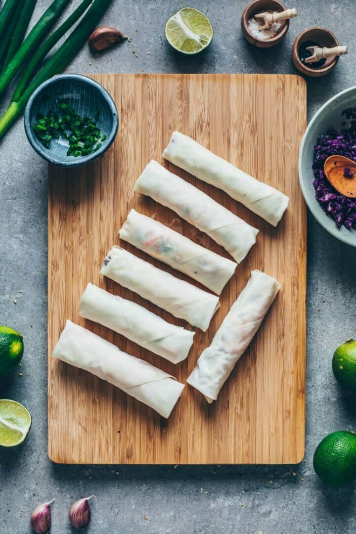 Crispy Vegan Spring Rolls Recipe is easy to make and delicious. The Chinese Spring Rolls are loaded with healthy vegetables and wrapped in a crispy rice paper. Gluten-free.