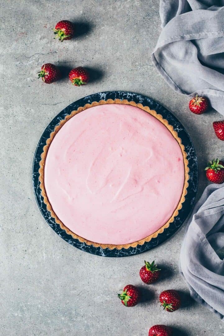 Strawberry ice cream pie with simple cookie crust and easy homemade ice cream which is soft, fluffy, creamy and requires no ice machine. Easy no-bake pie with whipped cream and fresh strawberries. Perfect summer dessert. Gluten-free, dairy-free, vegan recipe.