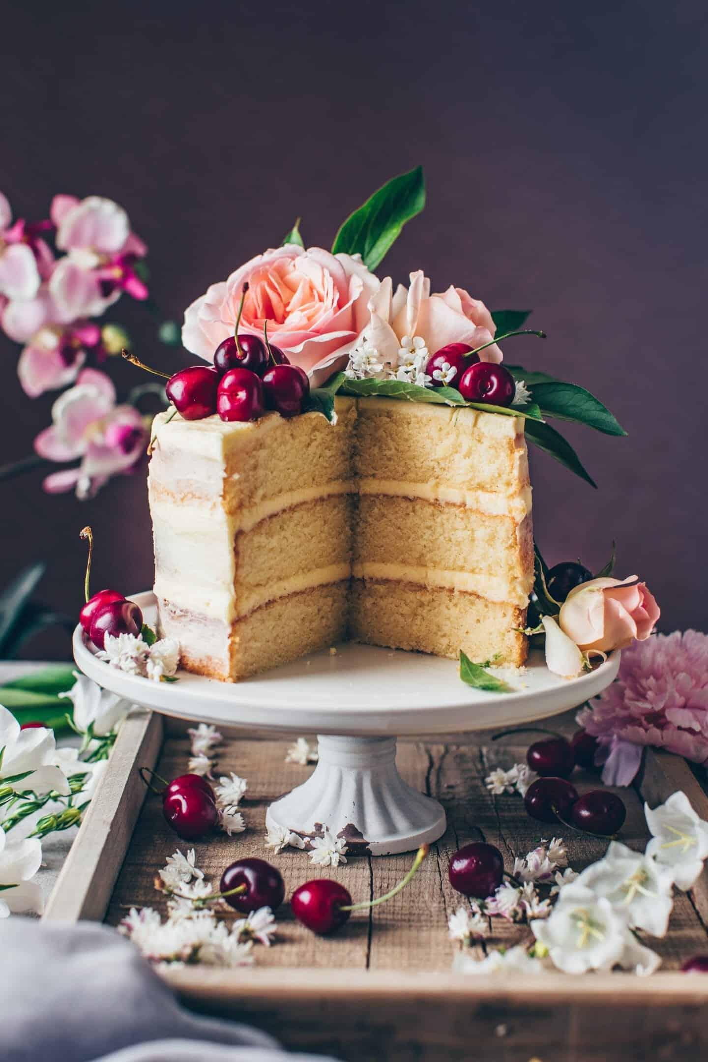 Vegan Vanilla Cake recipe. Soft and moist vanilla layer cake with vegan buttercream frosting. Easy Naked Cake.