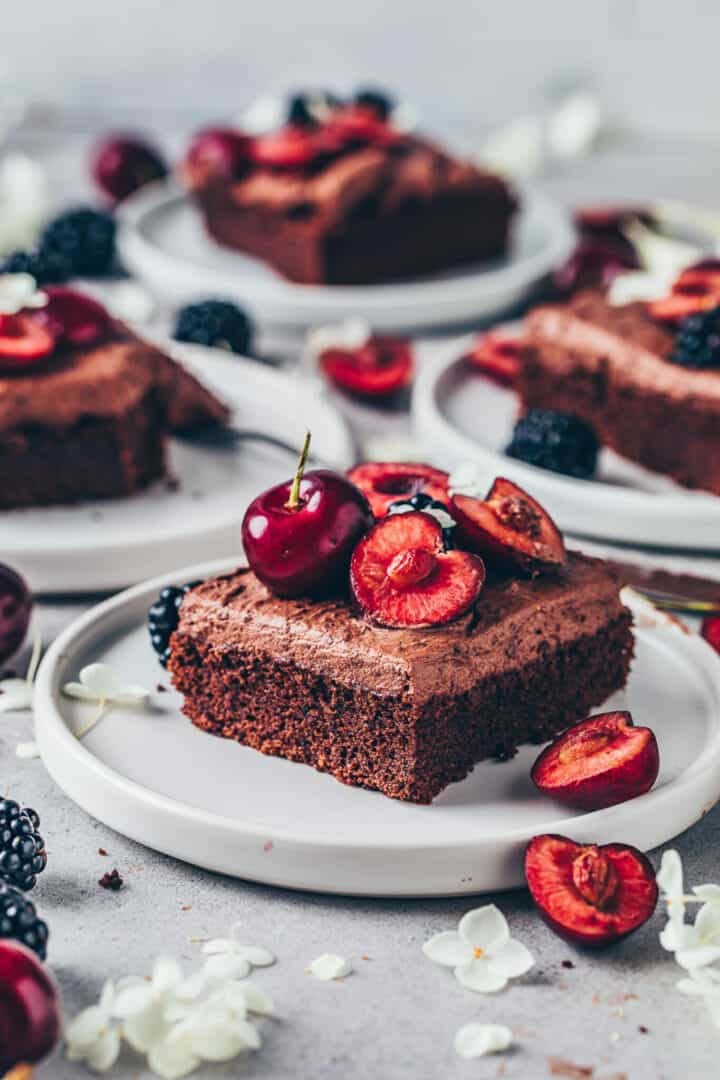 Chocolate cake with chocolate frosting, cherries and blackberries. Vegan brownie sheet cake.