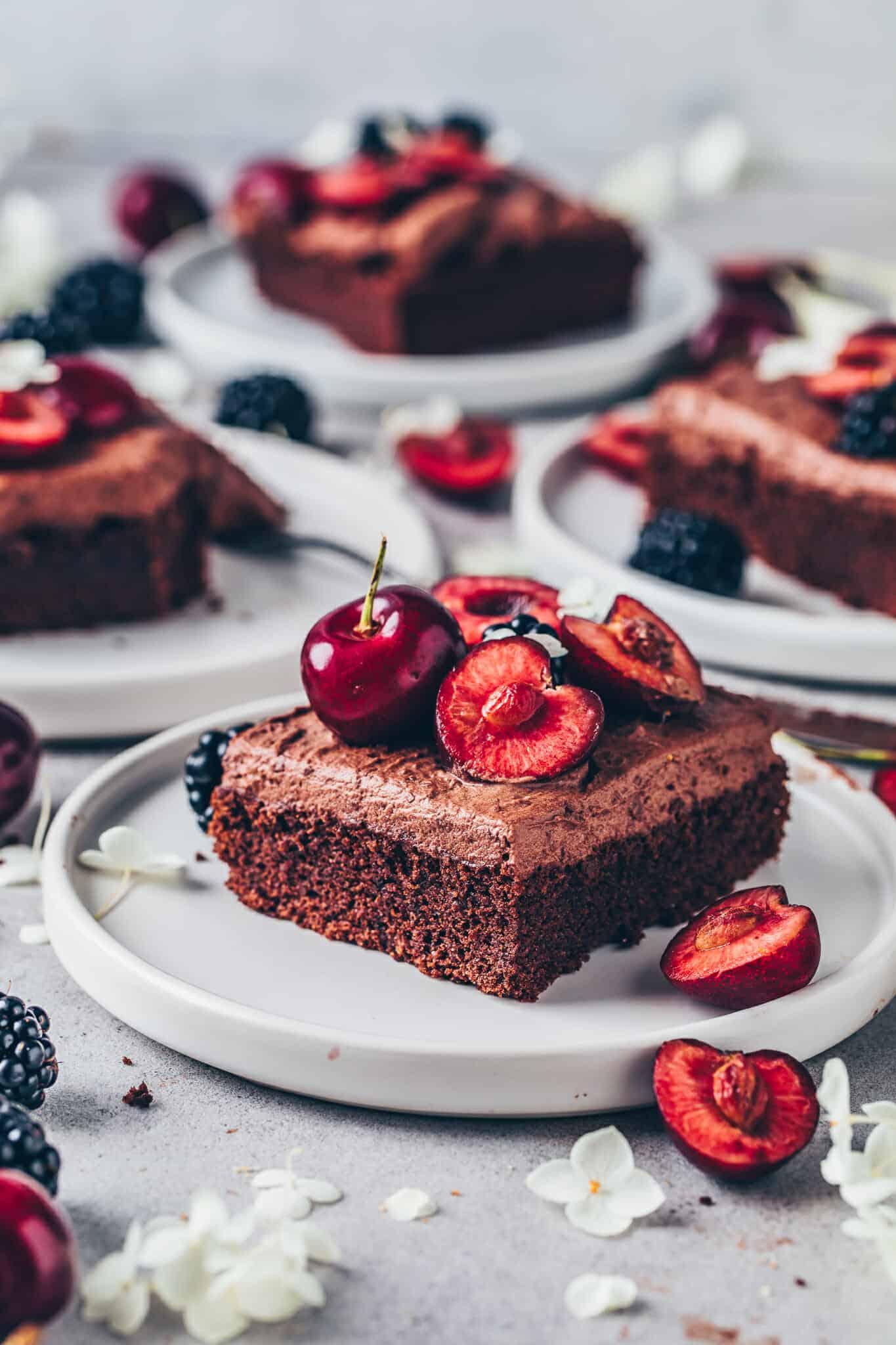 Chocolate cake with chocolate frosting, cherries and blackberries. Vegan brownie sheet cake.