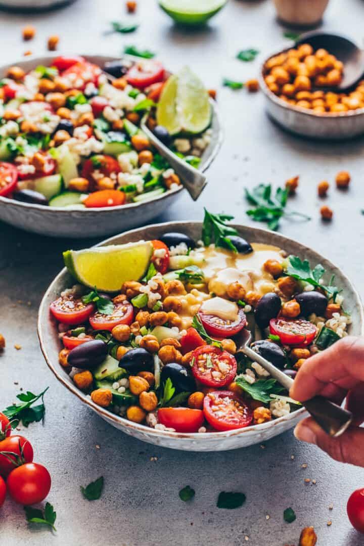 Mediterranean Chickpea Salad with Tahini Dressing, vegetables and crispy roasted chickpeas
