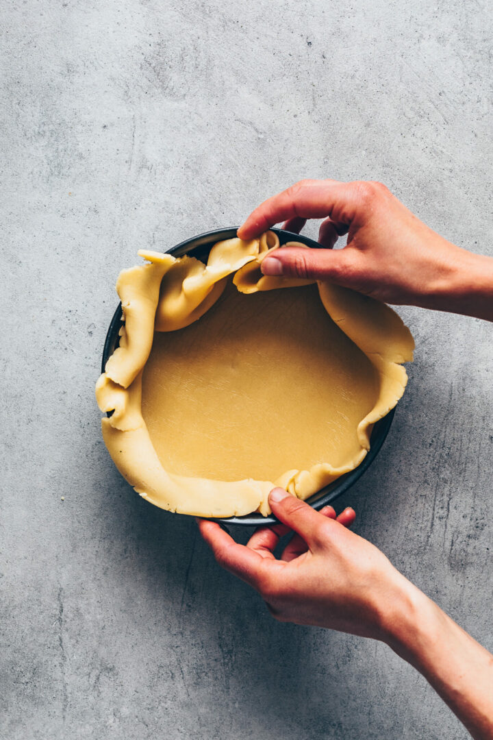 place shortcrust pastry dough in the springform pan