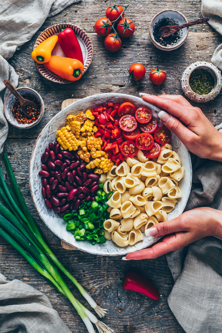 ingredients for Mexican pasta salad - rainbow bowl (beans, corn, tomatoes, green onions, pasta)