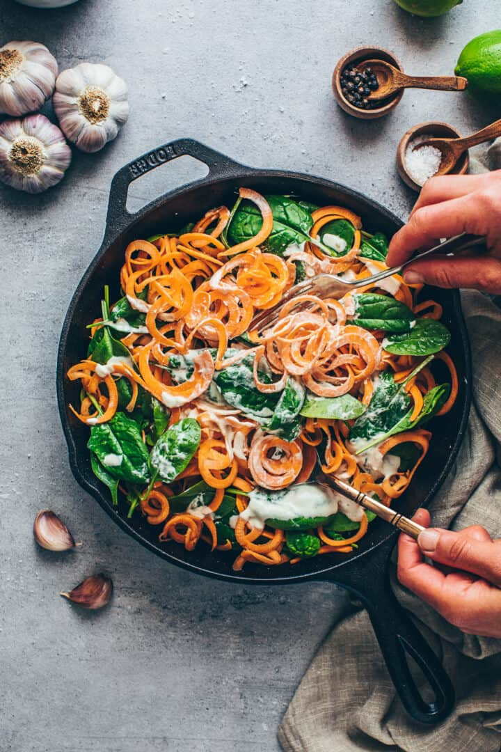 Sweet Potato Noodles with Spinach and creamy Cashew sauce. Vegan Alfredo Cheese sauce.
