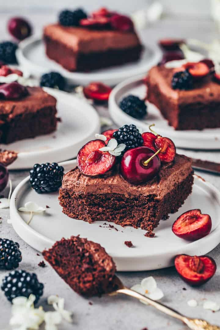 Chocolate cake with chocolate frosting, cherries and blackberries. Vegan brownie mousse sheet cake.
