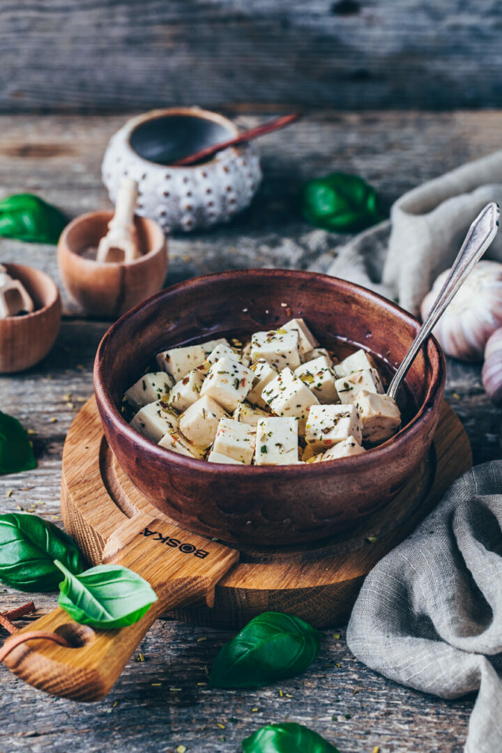 feta cheese in a bowl on a wooden cheese board | food photography & styling