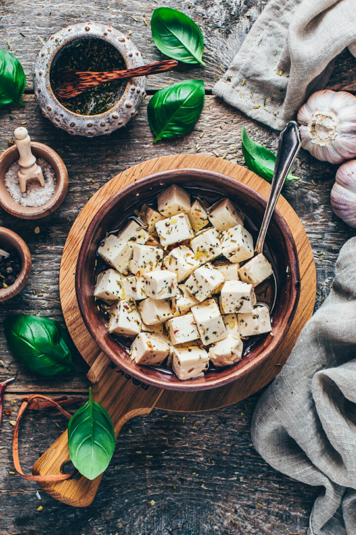 vegan feta cheese in a bowl on a wooden cheese board | food photography & styling