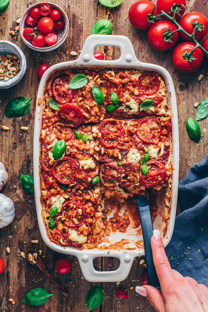 vegan lasagna with lentils, tomatoes, basil, pine nuts and cashew cheese sauce