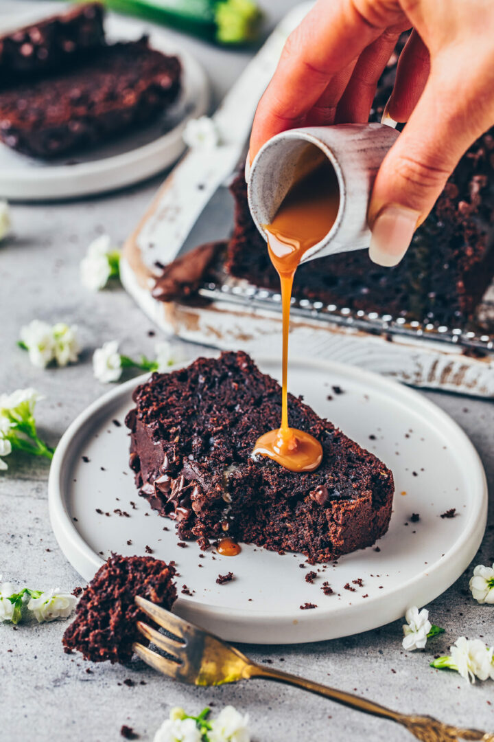 Best Chocolate Zucchini Bread that is moist, rich, fudgy, easy to make vegan chocolate cake with caramel sauce